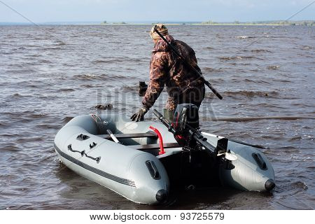 The Hunter With The Boat In Shoal