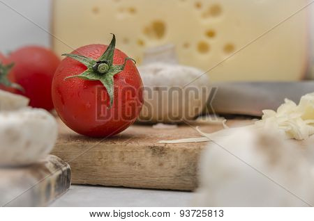 Fresh Tomato and Cheese Close Up Italian Food Preparation Moment