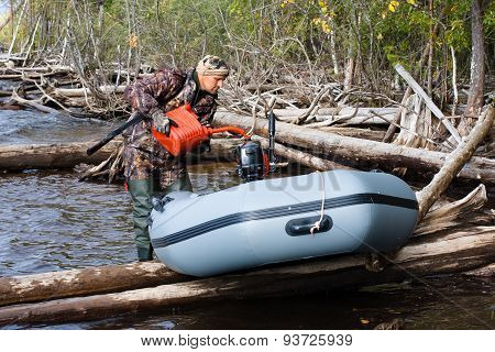 Hunter Pouring Fuel Into A Tank Of His Boat