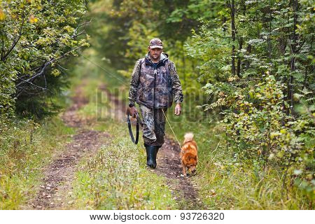 Hunter With Dog Waiting For Prey