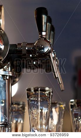Beer tap in the morning light ready to work