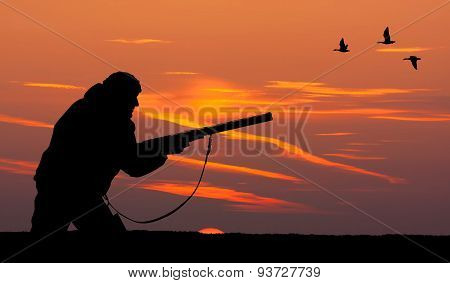 The Silhouette Of A Hunter At Sunset