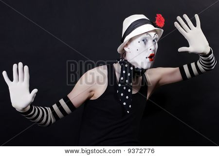 Funny Mime In White Hat With Red Flower
