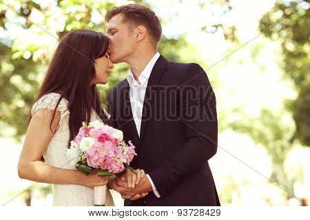 Groom Kissing His Bride On Forehead