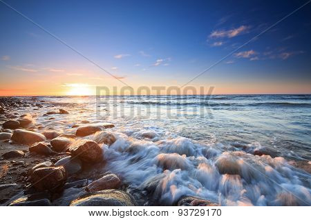 Sunset Over The Baltic Sea. The Pebbly Beach In Rozewie