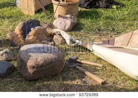 Ancient Clay Forge, Furs, Hammer And Other Tools
