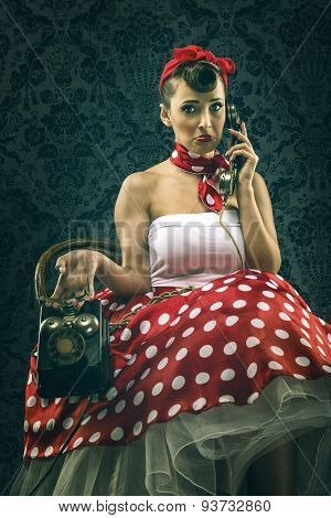 Vintage woman in old room with dial phone