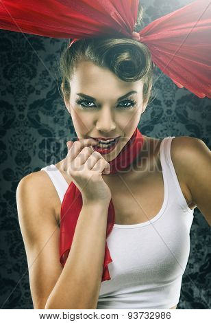 Vintage woman in red dress with big red bow