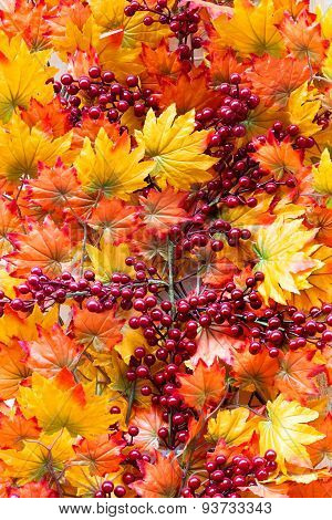 Creative Composition Decorative Autumn Orange And Yellow Leaves With Red Berries, Bright Background