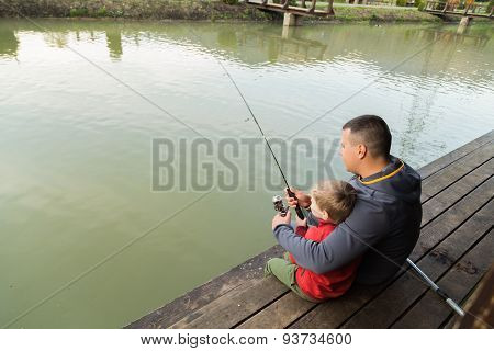Dad and son on fishing.