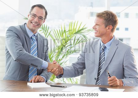 Businessmen shaking hands in an office