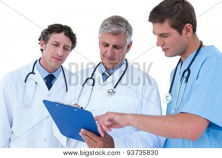 Doctors and nurse discussing over notes on a white background