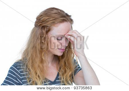 A blonde woman having headache on white background