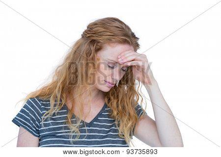Blonde woman having headache on white background
