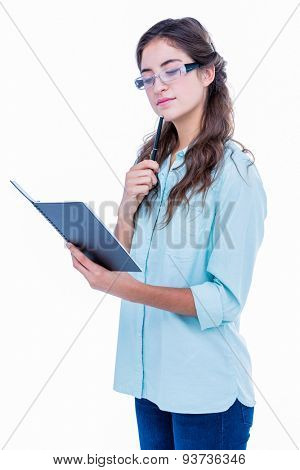 Pretty geeky hipster checking her notebook on white background