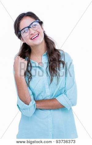 Pretty geeky hipster with a hand in her hair looking away on white background