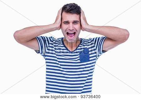 Furious hipster with hands on head on white background