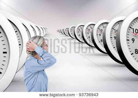 Businesswoman holding her head against grey background