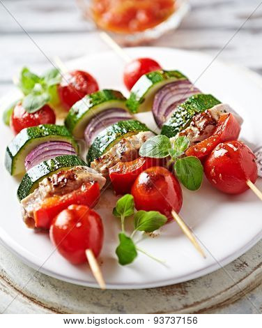 Grilled kebabs with vegetables and pork tenderloin
