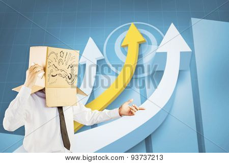 Anonymous businessman with his smartphone against digital blue background with arrows