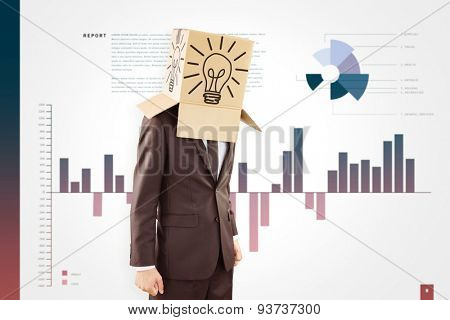 Anonymous businessman with hands down against business interface with graphs and data