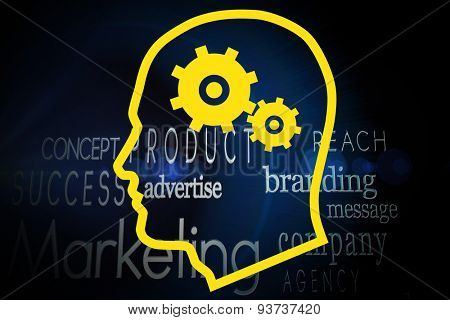 Cogs in head against marketing words on black background