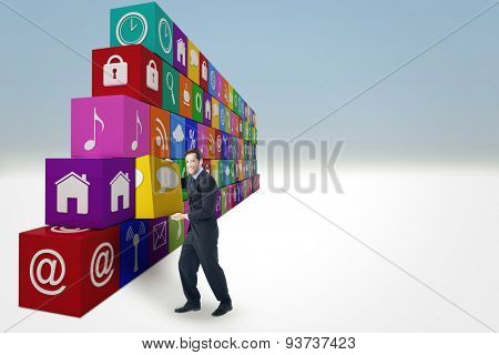 Businessman presenting with his hands against blue sky