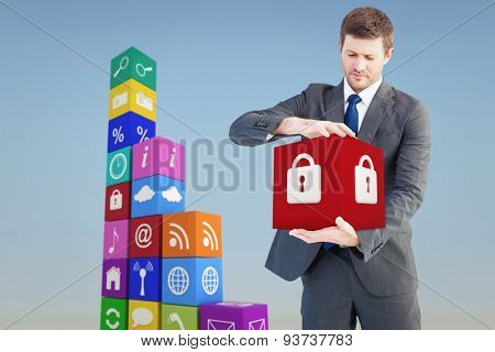 Businessman showing something with his hands against blue sky
