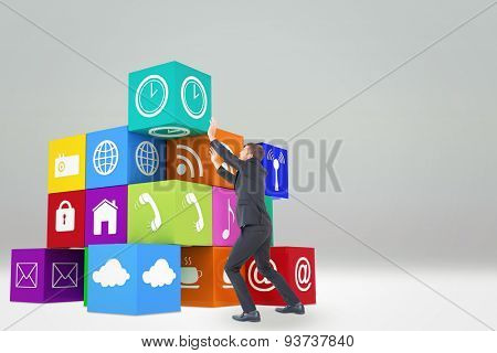 Businessman with his hands up against grey sky