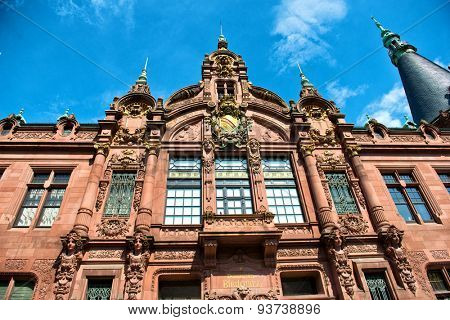 Low Angle View of Heidelberg University Library, Ornately Decorated Facade Above Entrance Against Blue Sky, Heidelberg, Baden-Wurttemberg, Germany