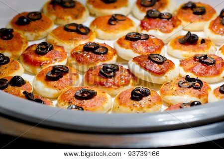 Round Meat Pies With Topping Black Olive Sliced On Buffet Line