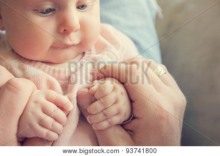 Infant Girl Holding Fathers Hands