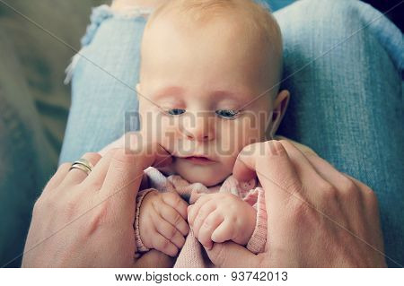 Sweet Newborn Baby Girl Holding Father's Hands