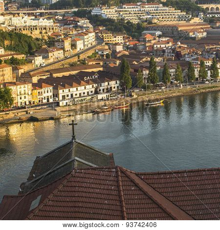 PORTO, PORTUGAL - JUNE 9, 2015: Douro river, top view of the side of Vila Nova de Gaia. UNESCO recognised Old Town of Porto as a World Heritage Site in 1996.