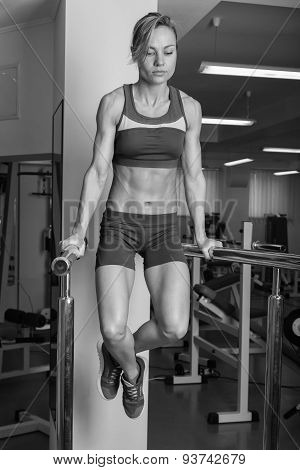 Sport blonde. Beautiful strong girl. Bodyfitness, women's fitness.