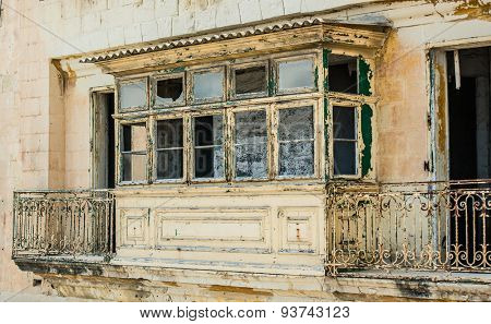 old ruined balcony in a street of historical center of Valletta in Malta