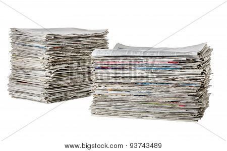 Two Piles Of Newspapers On A White Background