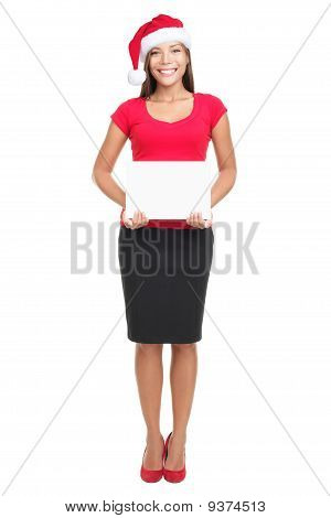 Santa Hat Businesswoman Holding Sign