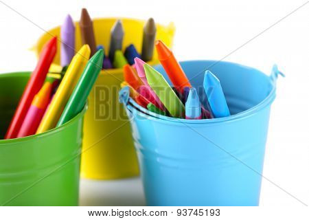 Colorful pastel crayons in holders isolated on white