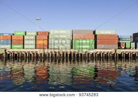 Los Angeles, California, USA - September 25, 2010:  Stacked dockside shipping containers in the congested Los Angeles harbor.
