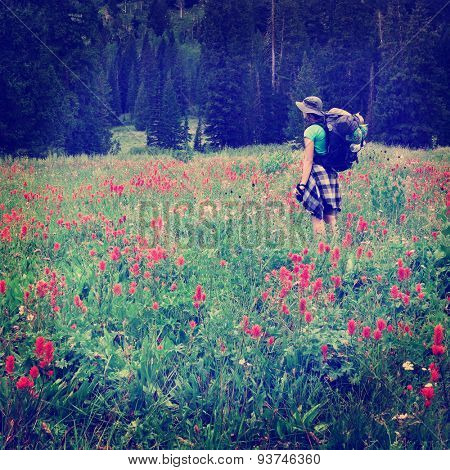 Woman young backpacking in wildflowers Instagram Style