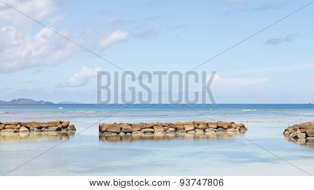 Seascape With A Breakwater In Seychelles
