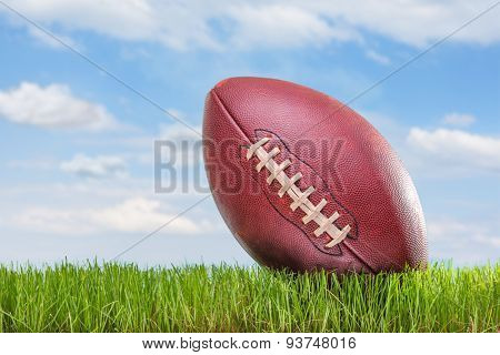 Close-up on an American football on a field outdoors