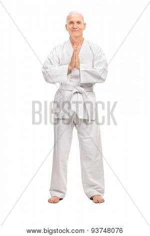Full length portrait of a senior man in a white kimono with a white belt looking at the camera isolated on white background