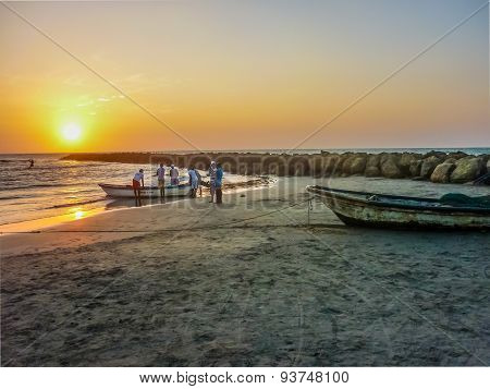 Fishermen At Sunset At The Beach In Cartagena