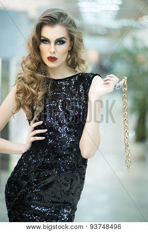 Attractive Woman In Dress With Gold Chain