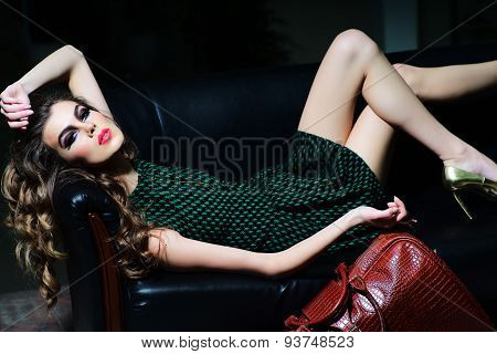 Slender Woman On Sofa