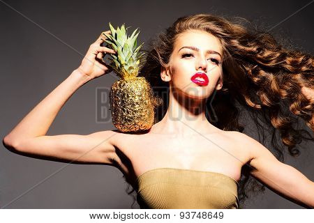 Graceful Young Girl With Golden Pineapple