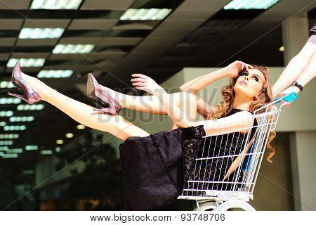 Girl In Shopping Trolley