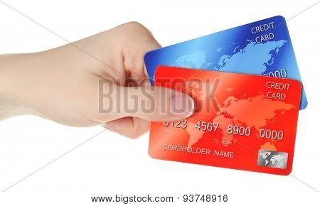 Hand holding credit cards, isolated on white